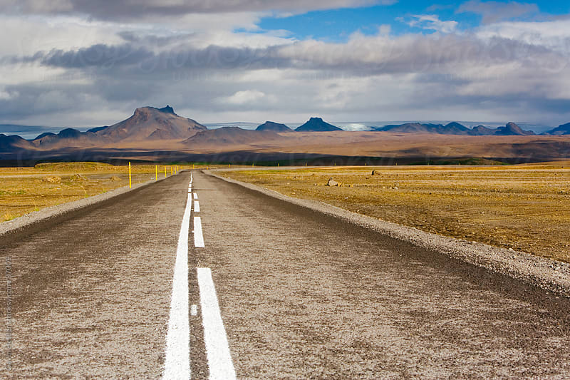 Iceland, Central Iceland, road leading into the interior under a stormy sky by Gavin Hellier for Stocksy United