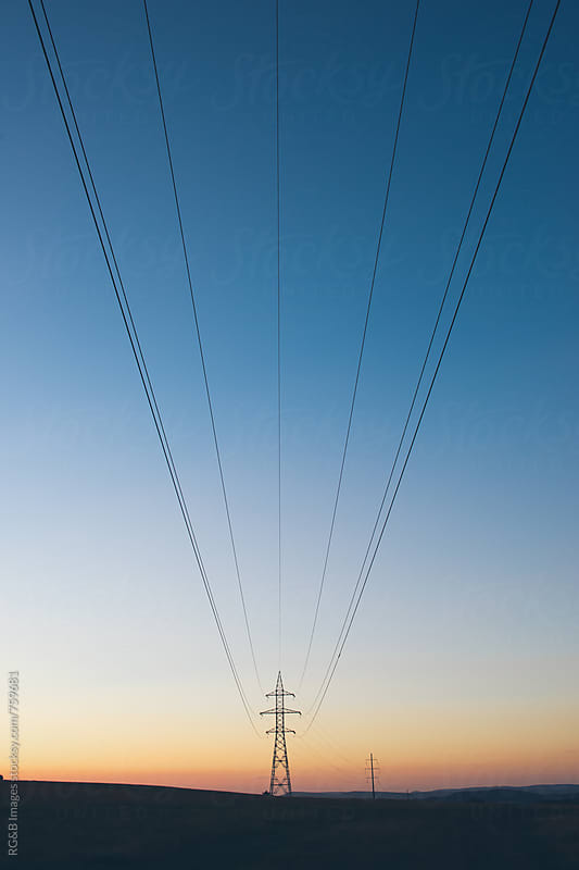 High-voltage lines crossing the sky by RG&B Images for Stocksy United