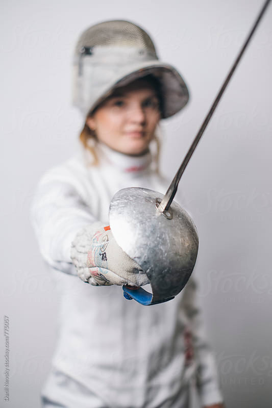 Female fencer holding sabre, soft focus by T-REX & Flower for Stocksy United