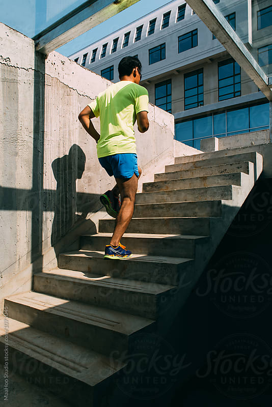 Young man running on stairs by Maa Hoo for Stocksy United