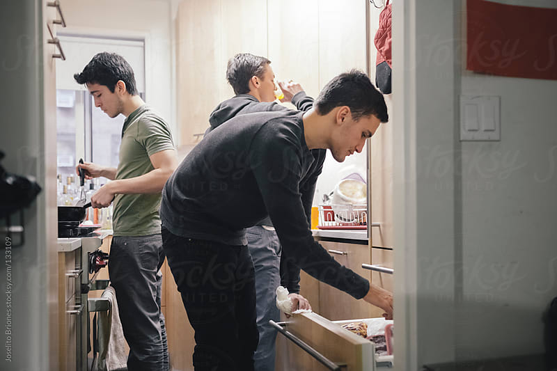 Student Roommates Preparing Breakfast in the Kitchen of their New York Apartment by Joselito Briones for Stocksy United