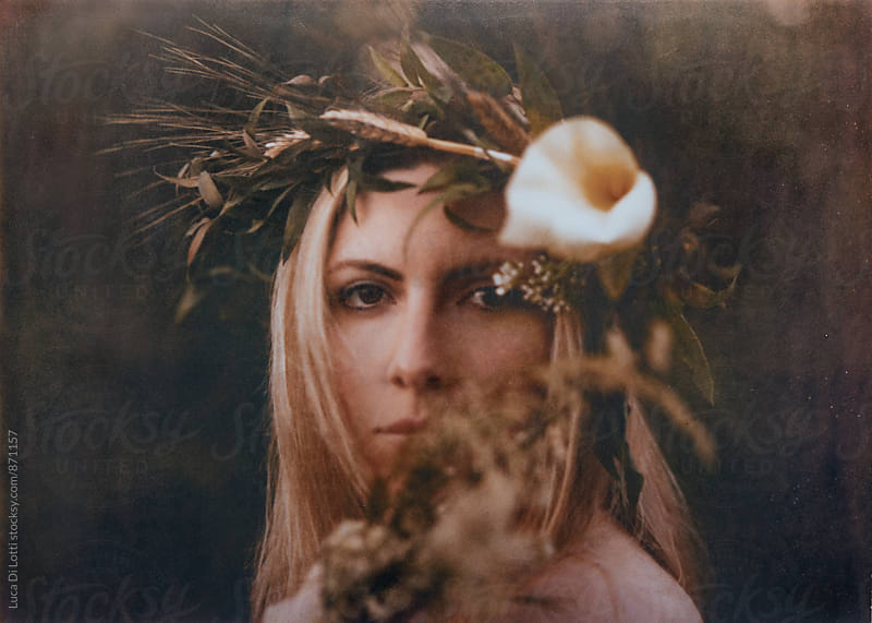 Polaroid film portrait of a lady wearing a flower crown by Luca Di Lotti for Stocksy United