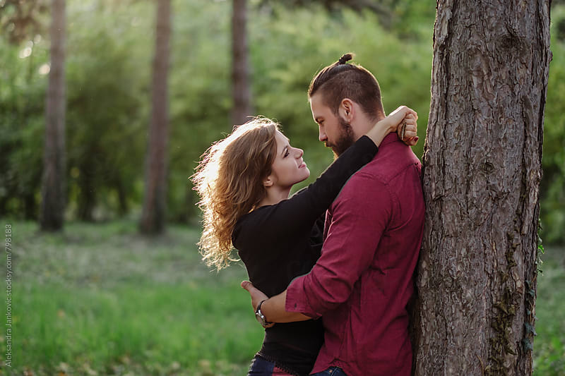 Embraced Young Couple in the Park by Aleksandra Jankovic for Stocksy United