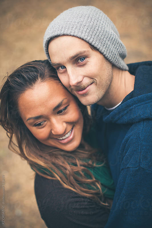 Portrait of attractive young couple outdoors. by Robert Zaleski for Stocksy United