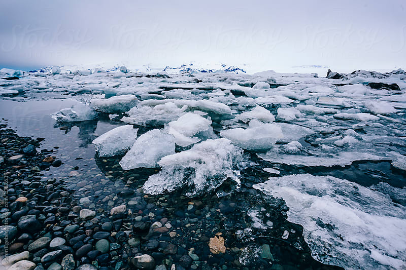 Floating ice in lagoon by Søren Egeberg Photography for Stocksy United