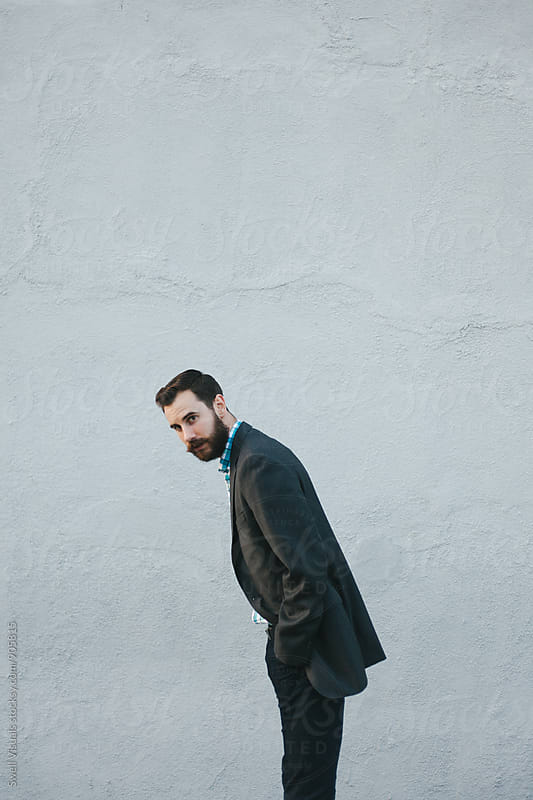 Young Male Professional With A Beard by Caleb Thal for Stocksy United
