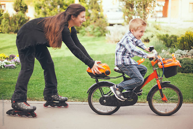 Mother and Son Riding a Bike by Lumina for Stocksy United