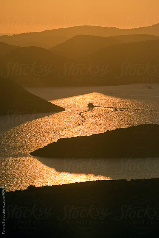 Twisting shiptrail on the glittering water among Kornati islands by Ferenc Boros for Stocksy United
