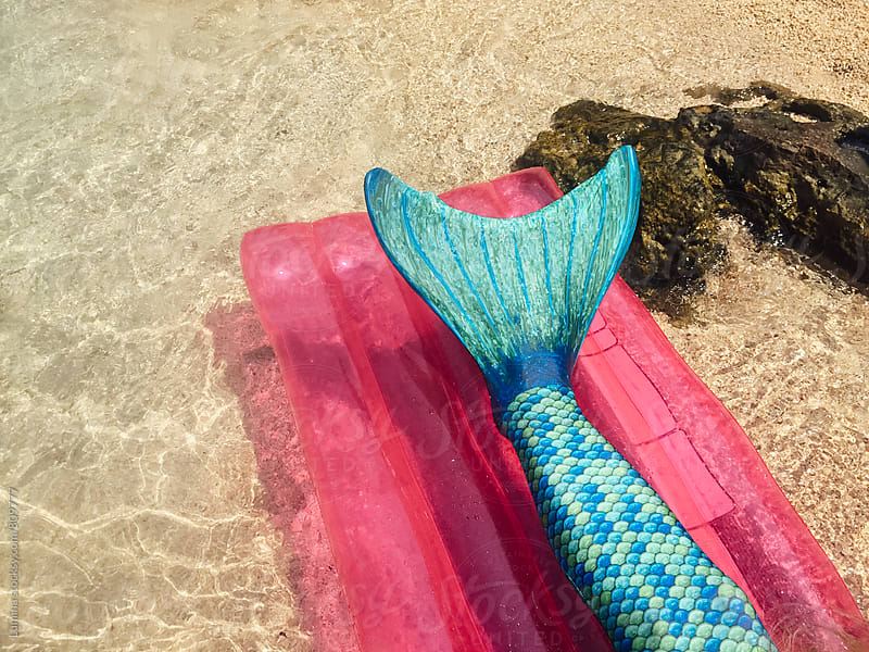 Mermaid Tail on a Sea Mattress by Lumina for Stocksy United