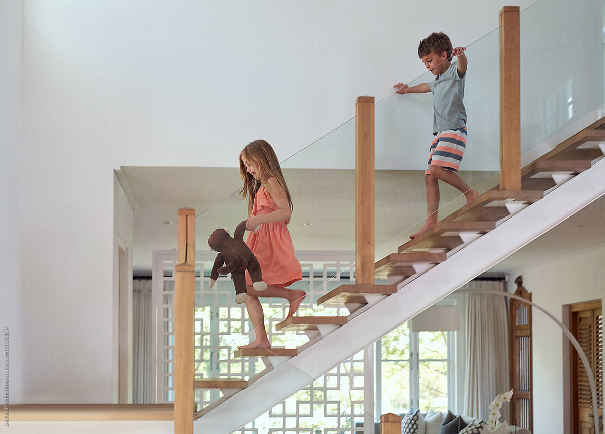 Kids Running Down Staircase By Daxiao Productions For Stocksy United
