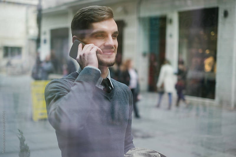 Young Man Talking on the Phone by Mosuno for Stocksy United