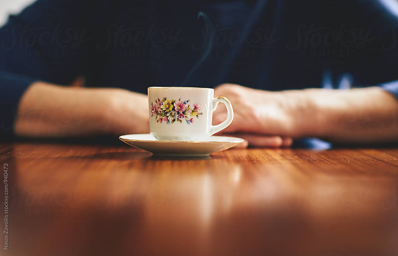Senior woman drinking coffee by Nasos Zovoilis for Stocksy United