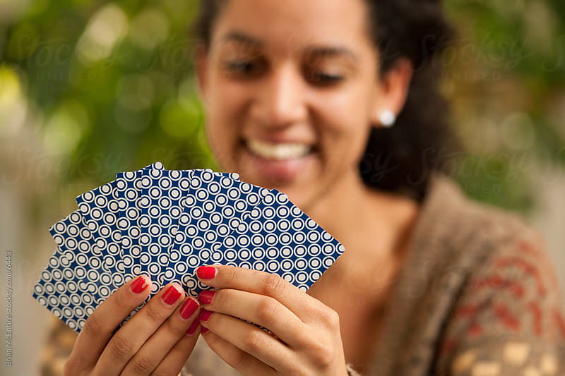 Young Women Playing Cards by Brian McEntire for Stocksy United