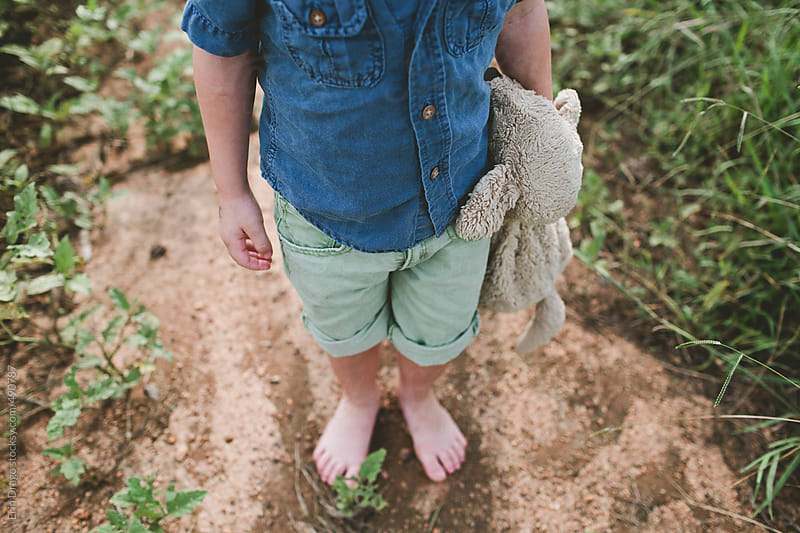 young boy with stuffed animal by Erin Drago for Stocksy United