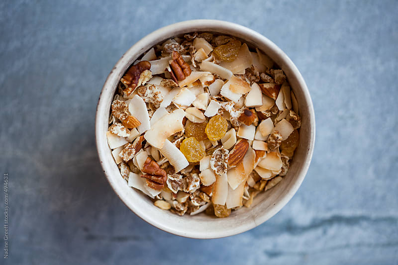 Breakfast Muesli with toasted coconut, seeds and nuts by Nadine Greeff for Stocksy United