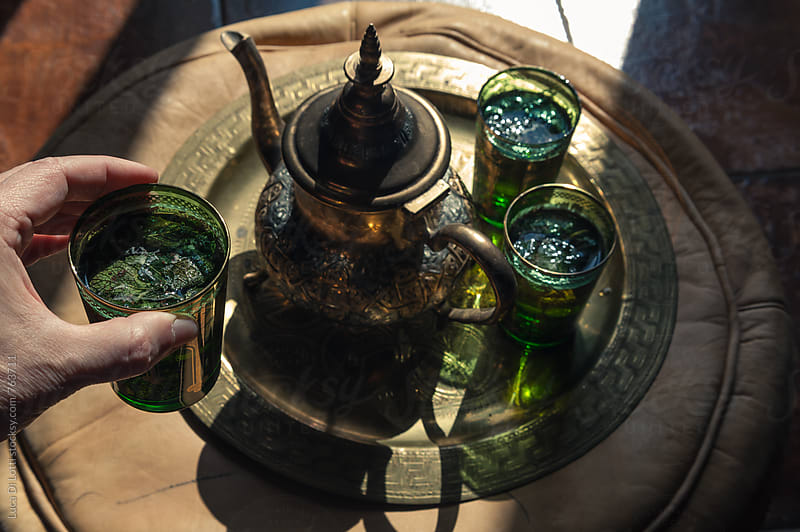 Green tea with mint served in artisanal glasses and teapot from Maghreb by Luca Di Lotti for Stocksy United
