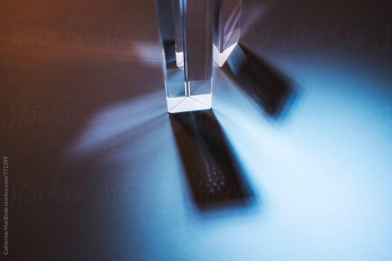 Glass prisms with light and shadows... by Catherine MacBride for Stocksy United