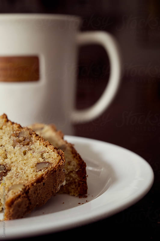 slices of banana bread with mug of tea by Samantha Wesselhoft for Stocksy United