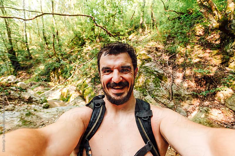 Male hiker in nature by Dimitrije Tanaskovic for Stocksy United