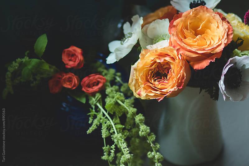 Colorful flowers in vases by Tari Gunstone for Stocksy United