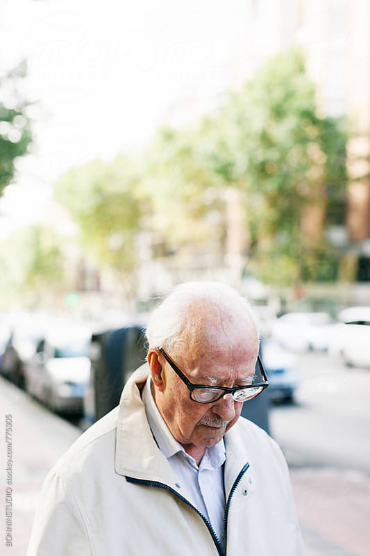 Elderly man walking on the street. by BONNINSTUDIO for Stocksy United