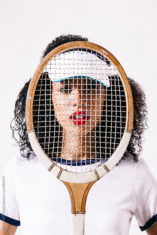 Portrait of a woman wearing fashion sport clothes. Tennis. by BONNINSTUDIO for Stocksy United
