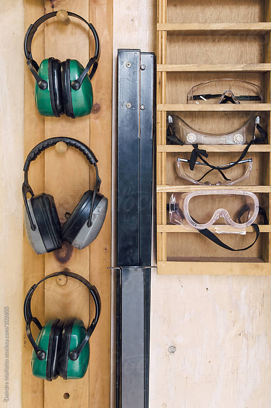 Hearing protectors and safety goggles  by Deirdre Malfatto for Stocksy United