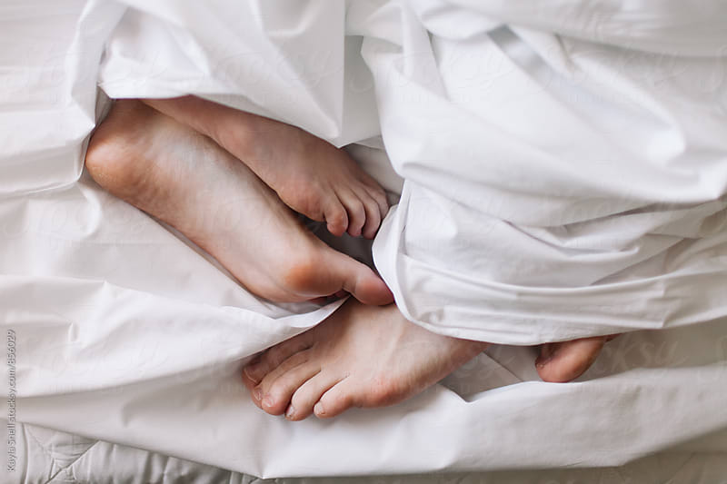 Couple in bed by Kayla Snell for Stocksy United