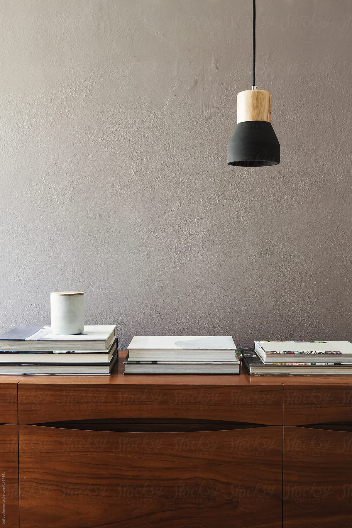 Image of: Mid Century Modern Buffet With Books And Pendant Light By Jodie Johnson Decor Interior Stocksy United