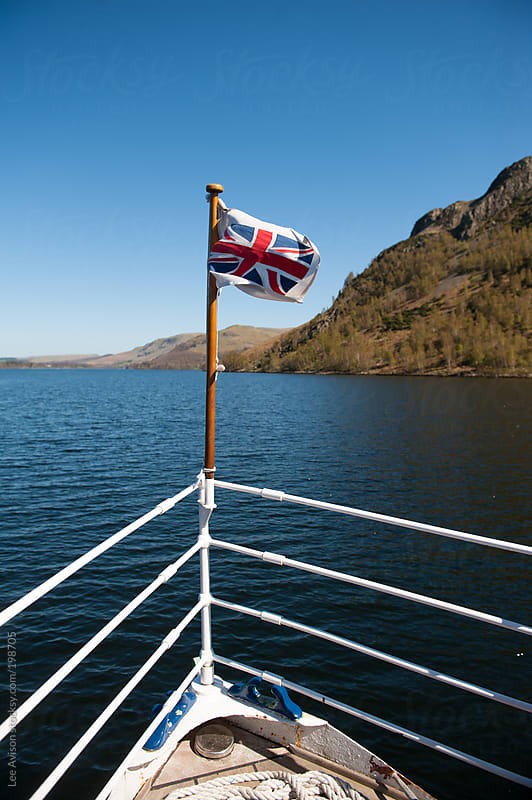 union jack flag on the bow of a boat by Lee Avison for Stocksy United