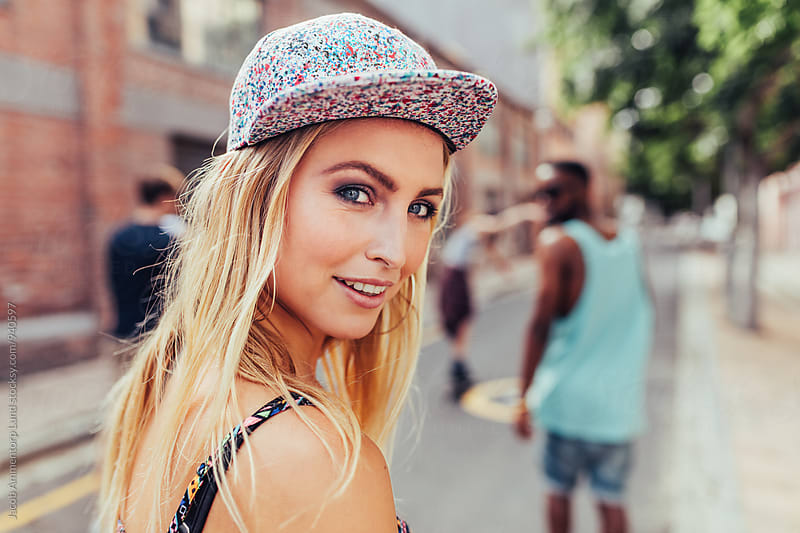 Attractive young woman on the city street by Jacob Lund for Stocksy United
