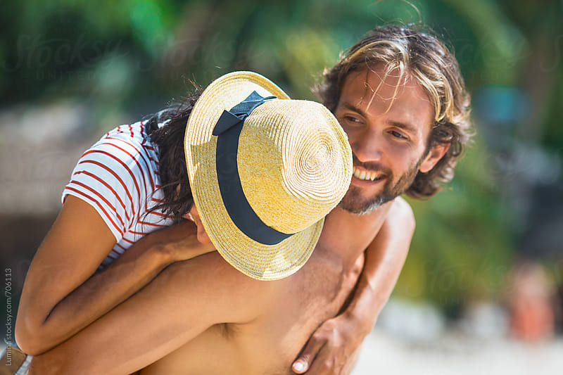 Couple Having Fun on the Beach by Lumina for Stocksy United