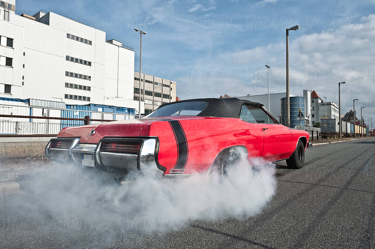 Red Muscle Car Burnout Stocksy United