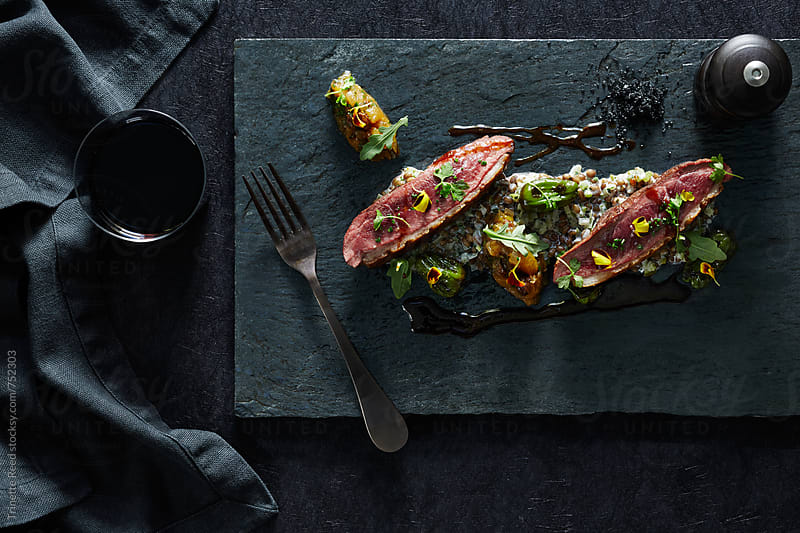 Duck Breast Dinner on Slate with Red Wine by Trinette Reed for Stocksy United