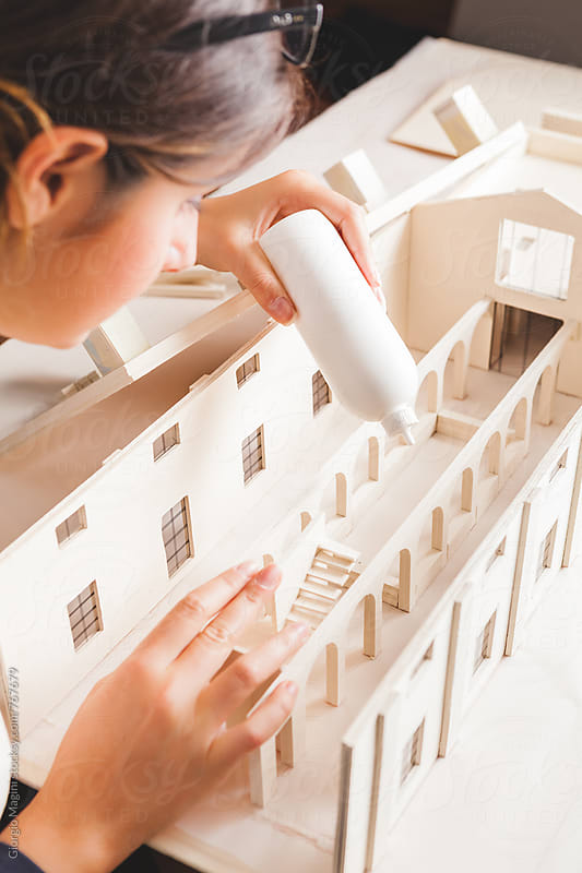 Young Female Architect Building an Housing Model Made of Cardboard by Giorgio Magini for Stocksy United
