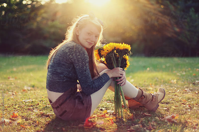 Sunflower girl II by Kitty Gallannaugh for Stocksy United