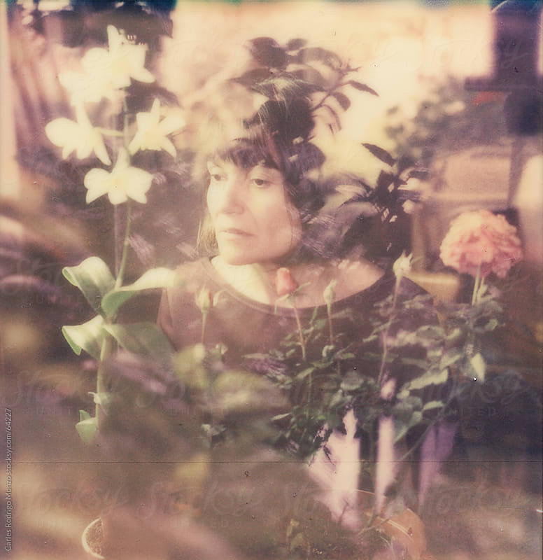 Portrait with reflections and flowers by Carles Rodrigo Monzo for Stocksy United