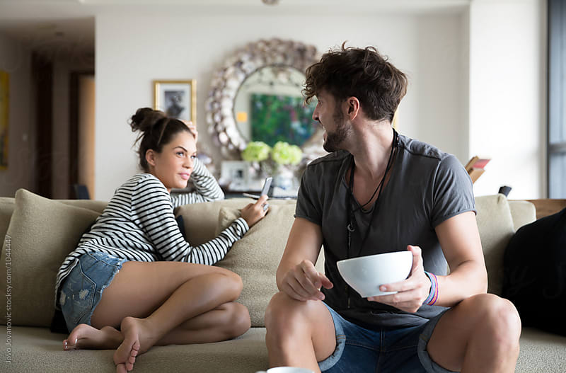 Couple relaxing at home by Jovo Jovanovic for Stocksy United