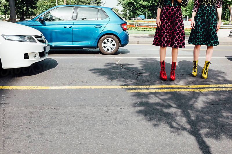 Colourful Boots on Two Fashion Models  by Katarina Radovic for Stocksy United