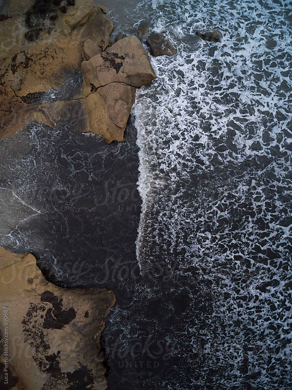 Aerial view of a beach in winter by Luca Pierro for Stocksy United
