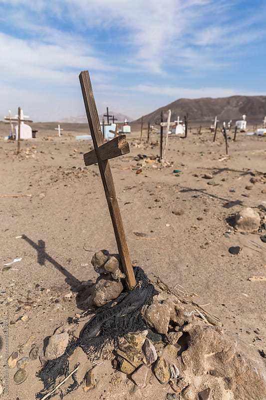 Desert cemetary withcrosses and headstones in Chauchilla Peru by Ben Ryan for Stocksy United