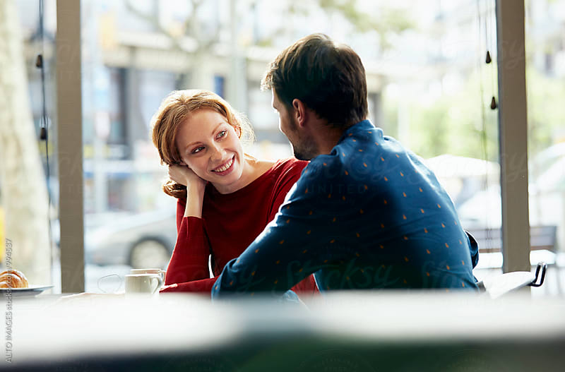 Smiling Woman Talking With Man In Restaurant by ALTO IMAGES for Stocksy United