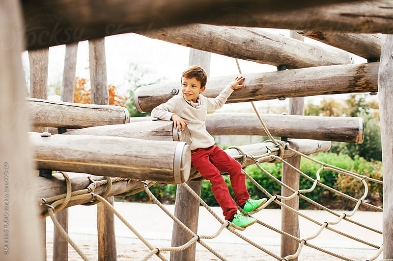 Little boy having fun in a playground. by BONNINSTUDIO for Stocksy United
