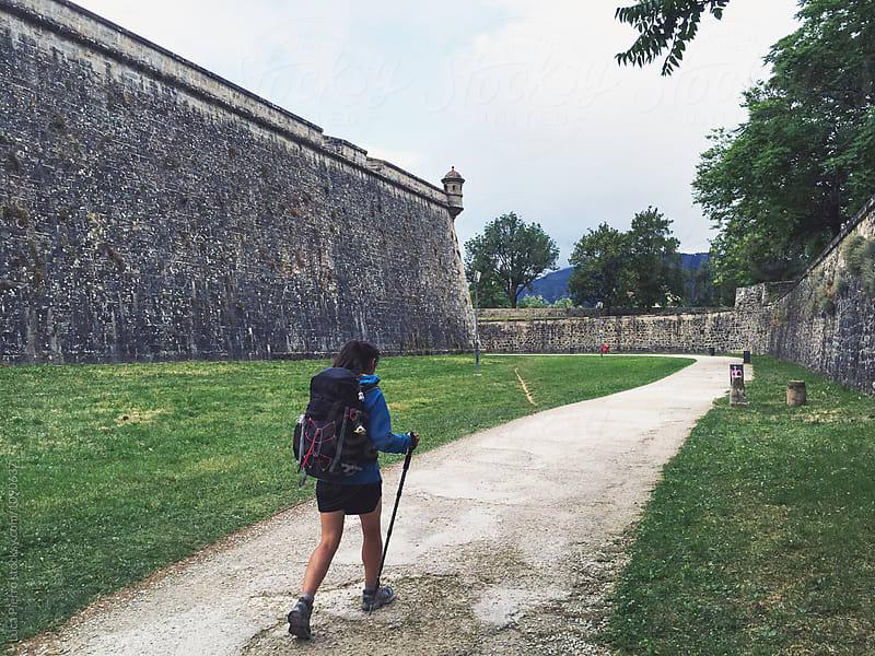 Pilgrim walking in Pamplona, Camino de Santiago by Luca Pierro for Stocksy United