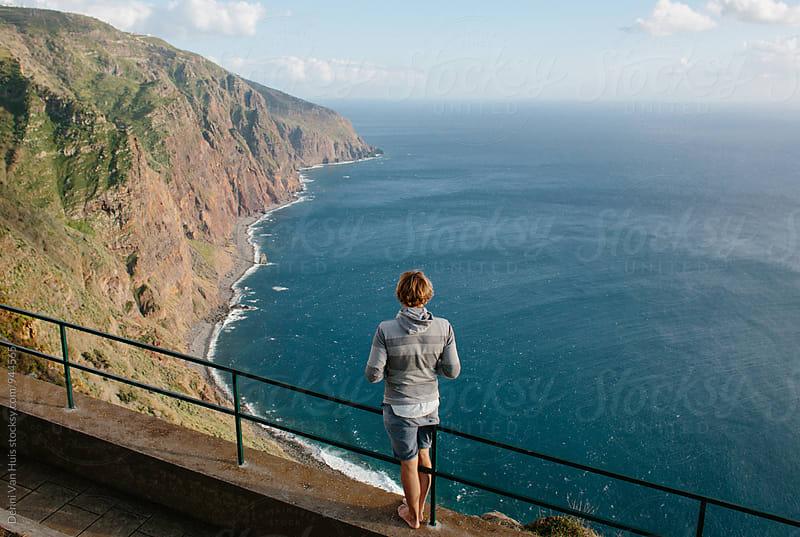 Man overlooking the ocean by Denni Van Huis for Stocksy United