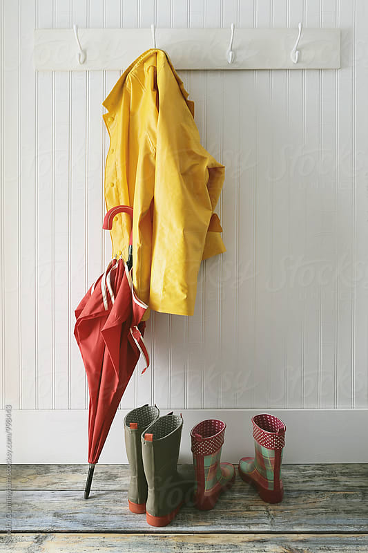 Rain jacket with umbrella and boots by Sandra Cunningham for Stocksy United