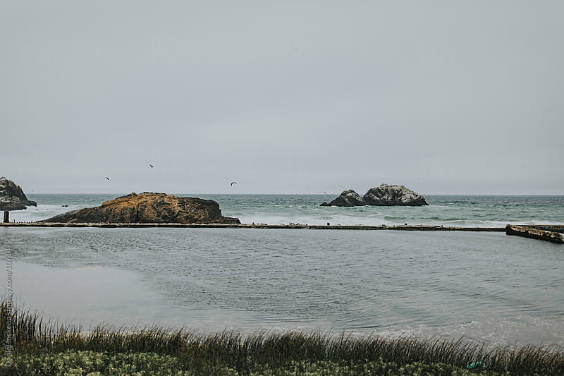 A View of the Sutro Baths in Front of the Pacific Ocean by Daniel Inskeep for Stocksy United