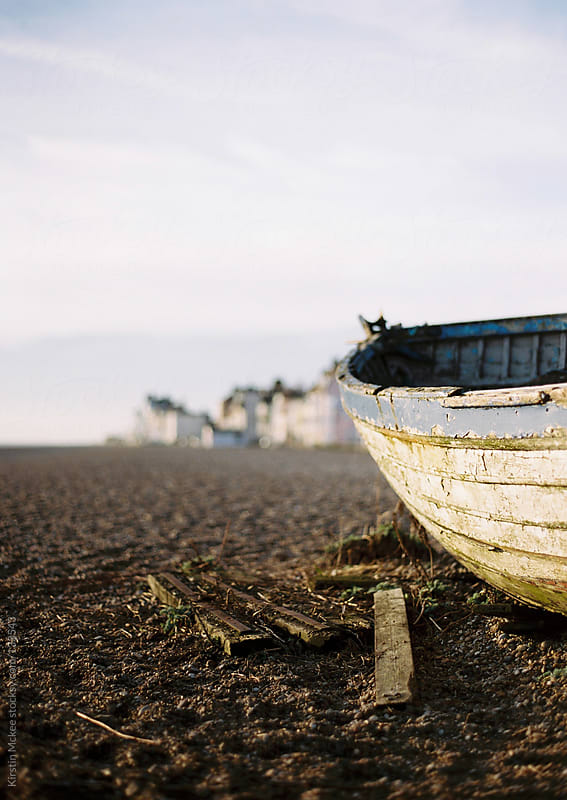 Fishing boat with Aldeburgh in the background.  by Kirstin Mckee for Stocksy United