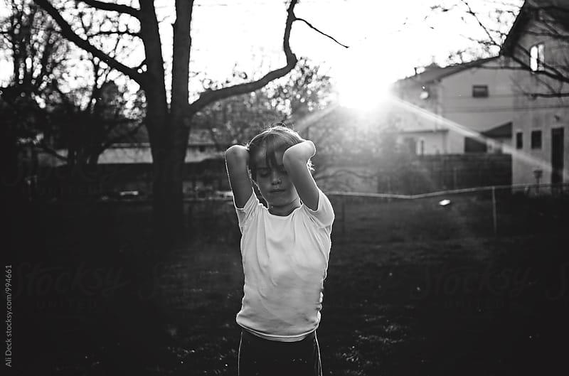 Boy in the Backyard by Ali Deck for Stocksy United
