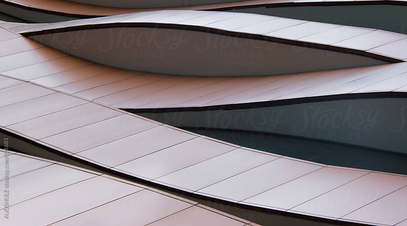 Abstract curved line details on building exterior. by Marko Milanovic for Stocksy United